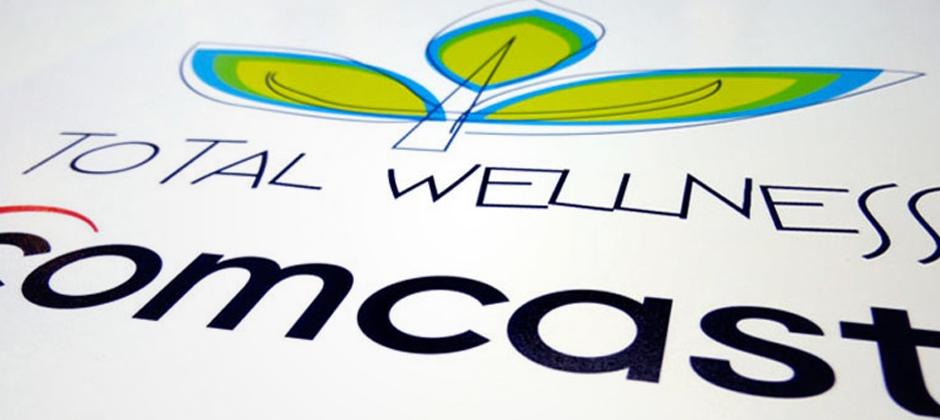 Comcast-total-wellness-logo-slanted  large